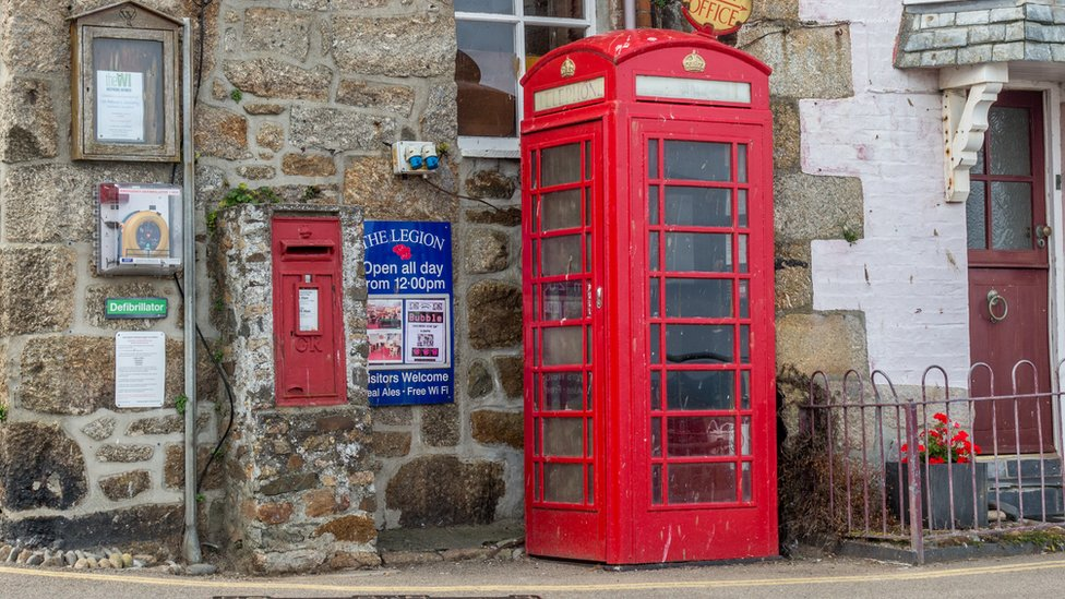 A red telephone box in a Cornish village