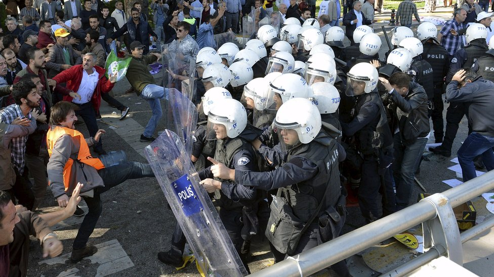 Riot police officer taking on a crowd after explosions in Ankara, Turkey, Saturday 10 October 2015