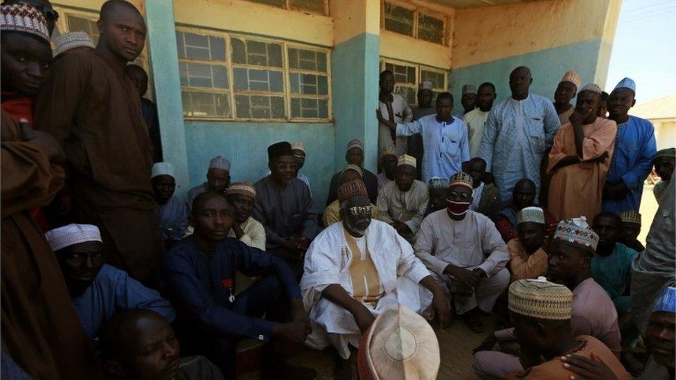Parents gather during a meeting at the Government Science school after gunmen abducted students from it, in Kankara, in northwestern Katsina state, Nigeria December 13, 2020