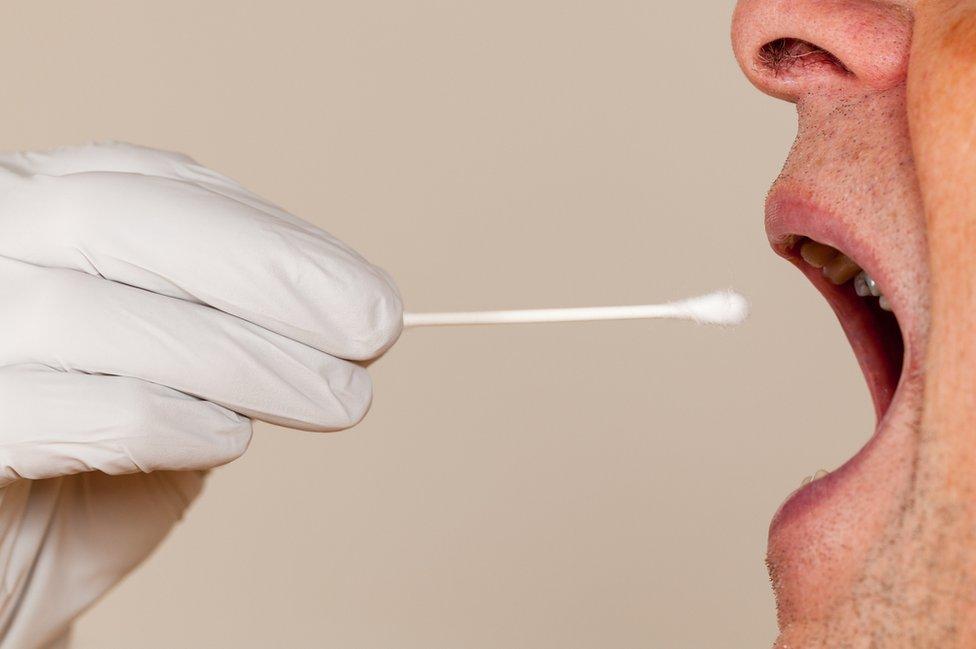 Man having a saliva DNA test