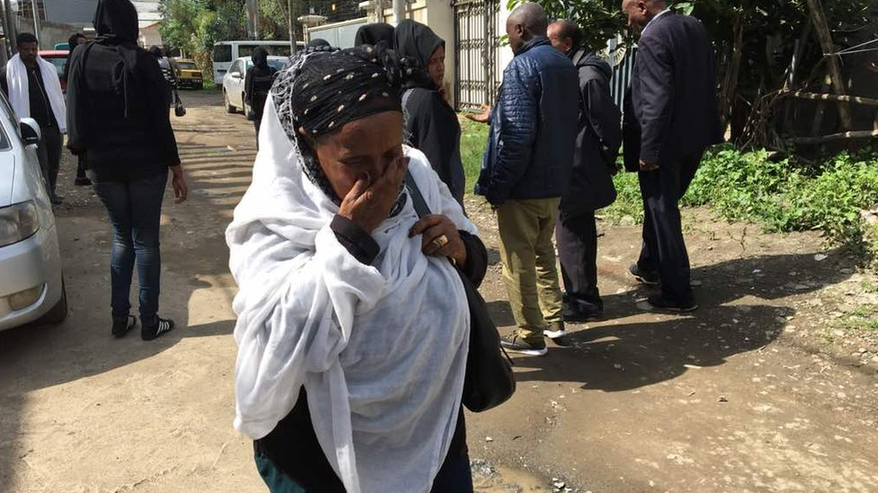 A woman cries as mourners gather near the house of Ethiopian engineer, Simegnew Bekele.