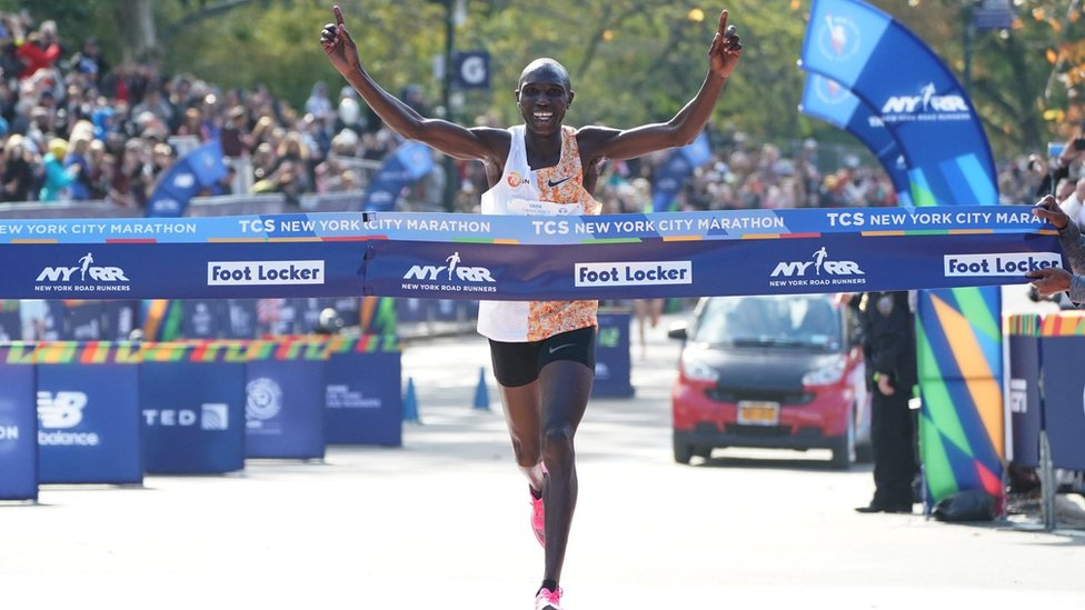 Geoffrey Kamworor of Kenya crosses the finish line to win the Professional Men's during the 2019 TCS New York City Marathon in New York on November 3, 2019.