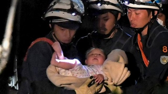 Rescuers with baby girl