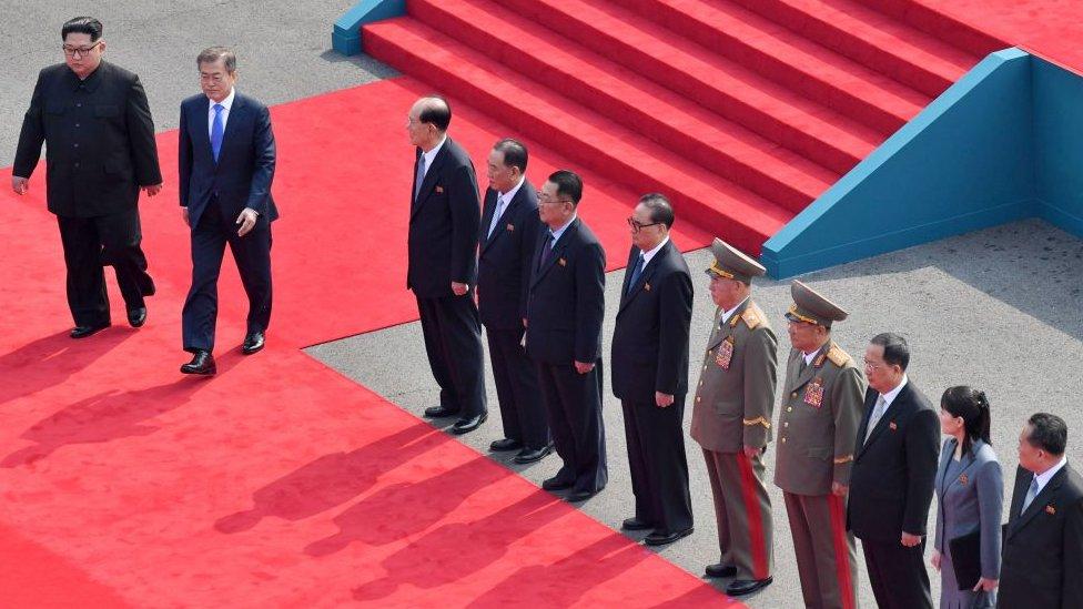 Kim Jong-un and Moon Jae-in walk on a red carpet ahead of historic talks