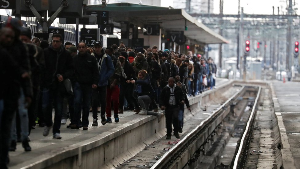 Commuters walk on a platform at Gare de Lyon train station in Paris during a nationwide strike