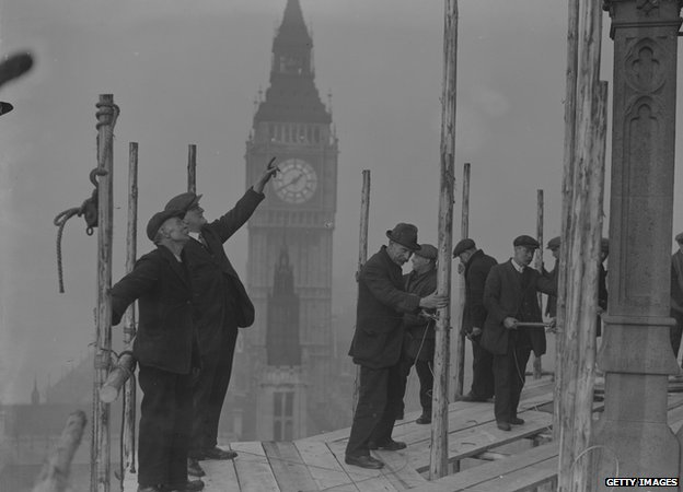 Restoration workers restore the Central Tower of the House of Commons, 1929