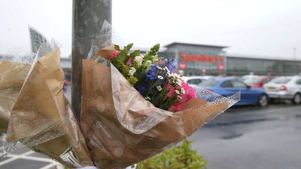 Floral tributes left at scene of shooting