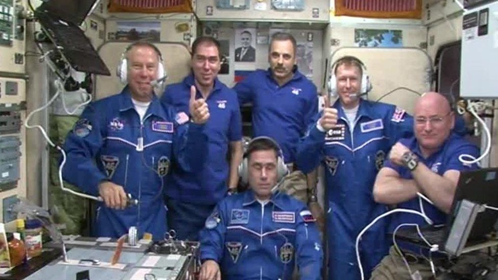 Screen grab from footage issued by European Space Agency of British astronaut Tim Peake with fellow crew members on the International Space Station.