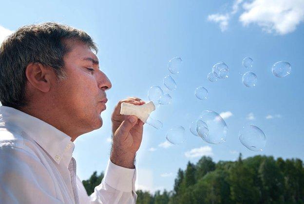 Macchiarini blowing bubbles through his synthetic tracheas