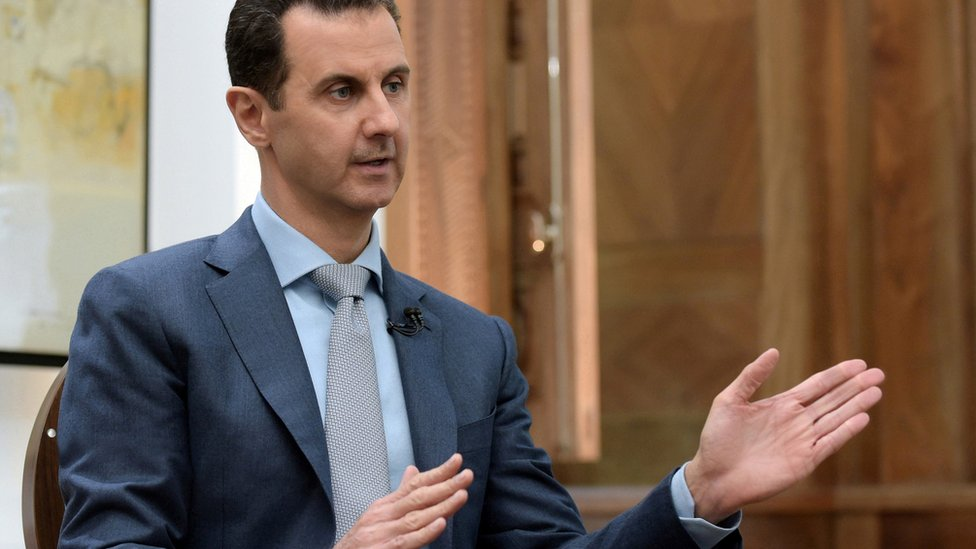 Syria's President Bashar al-Assad speaks during an interview with Yahoo News (10 February 2017)