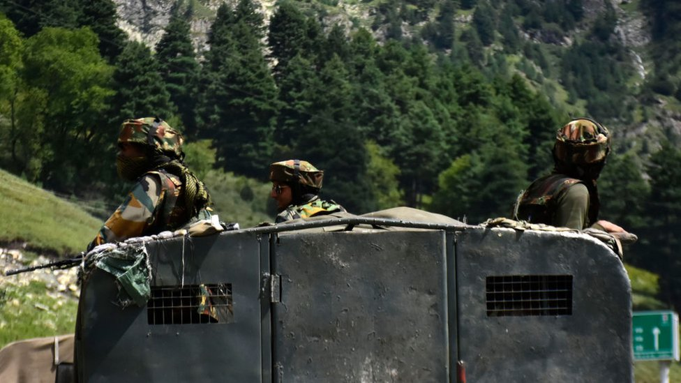 Indian arm officers stand atop a paraillitary vehicle at Gagangeer area of Ganderbal district as the standoff escilates on 07 September 2020