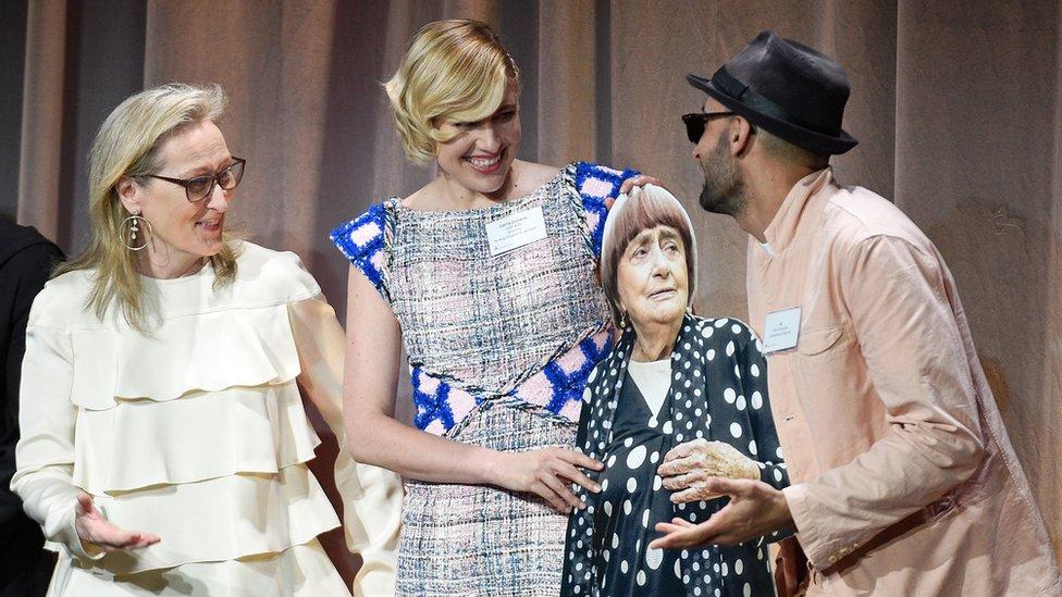 Meryl Streep (l), Greta Gerwig (centre) and JR (r) with a cardboard cut-out of Varda