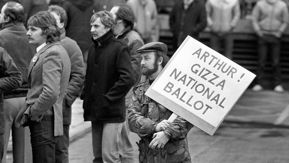 """A Leicester miner from the Power Group holds a placard addressed to National Union of Miners President Arthur Scargill, outside the NUM""""s Sheffield headquarters when Scargill spoke to the Leicester miners."""