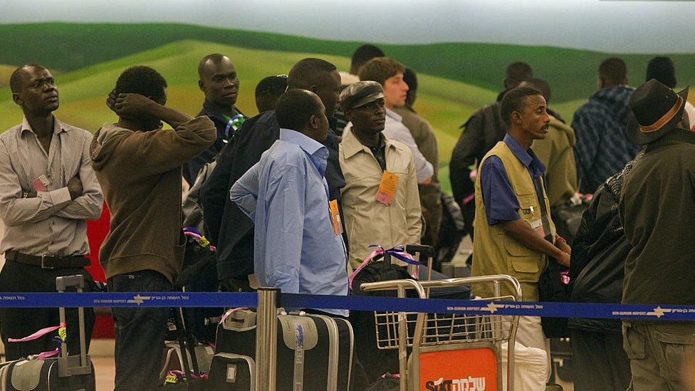 Some 150 refugees stand in line as they are sent back to Sudan on 13 December 2010 from the Ben Gurion Airport near Tel Aviv