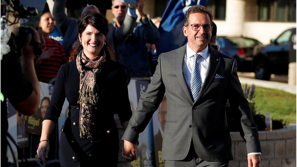 Bloc Québécois leader Yves-Francois Blanchet, accompanied by his wife, arrives for the federal election debate