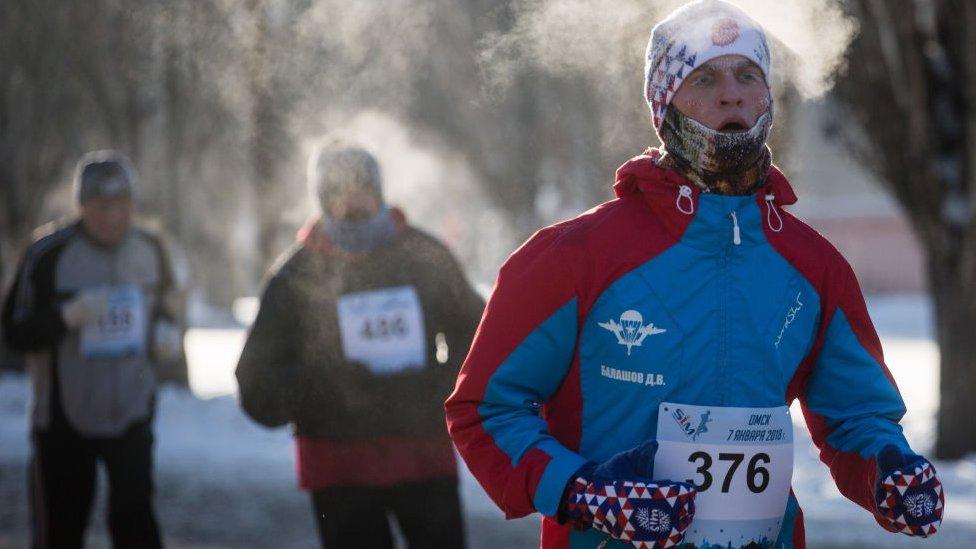 Runner participating in a half marathon in Russia.