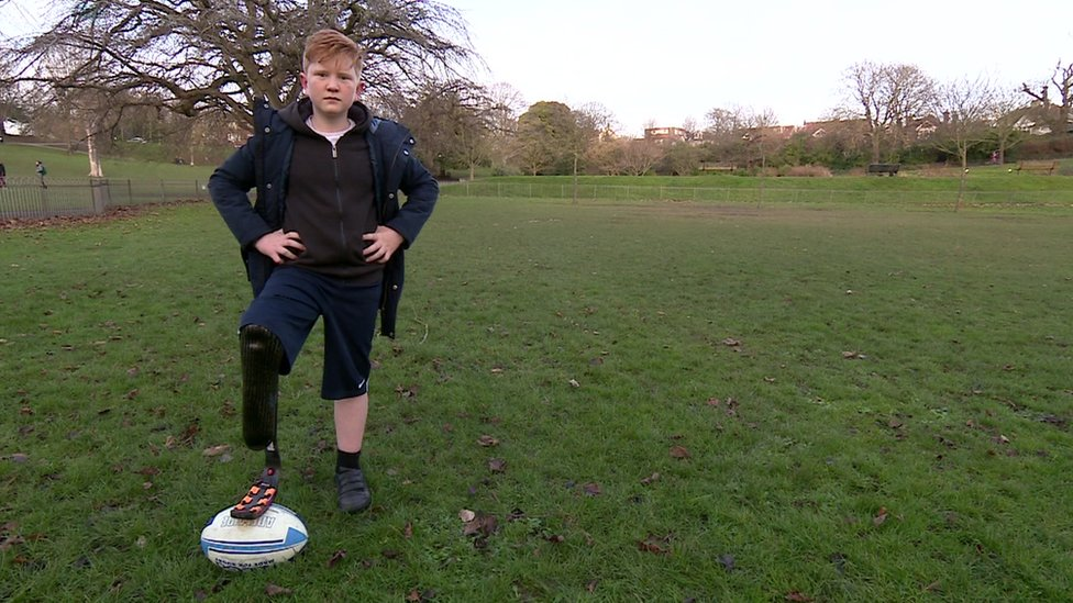 Ben playing rugby