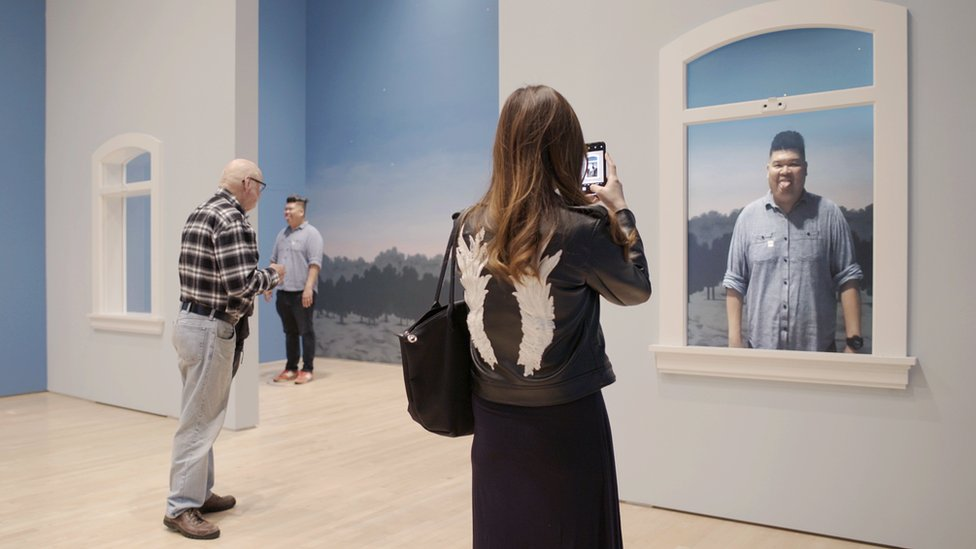 People at Rene Magritte exhibition in San Francisco
