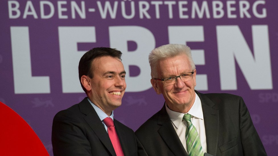 Nils Schmid (L), top SPD candidate for state elections in Baden-Wuerttemberg, and Winfried Kretschmann, top candidate of the Greens and current state premier in campaign event in Karlsruhe - 9 March