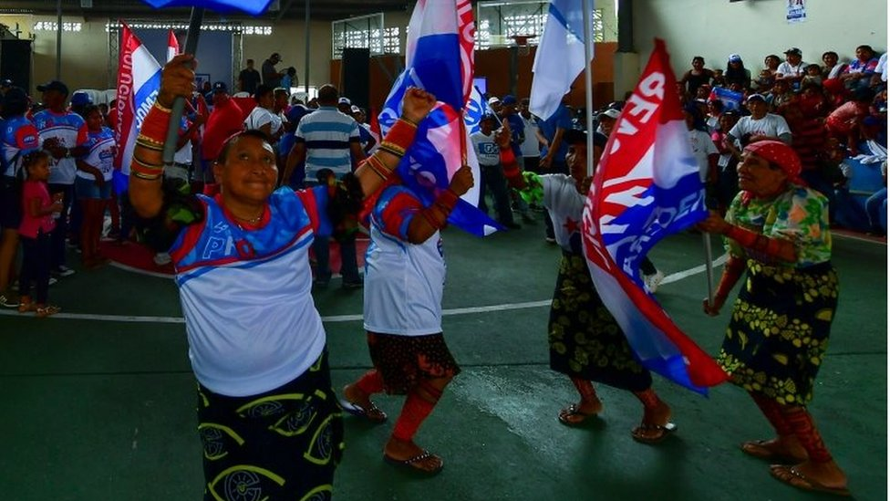 Voters dance during a campaign rally of Panamanian presidential candidate Laurentino Cortizo, of the Democratic Revolutionary Party (PRD), in Arraijan, near Panama City, on April 14, 2019.