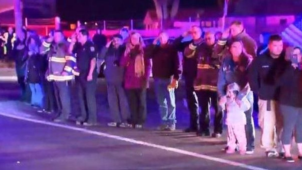 People pay respect to the slain deputy