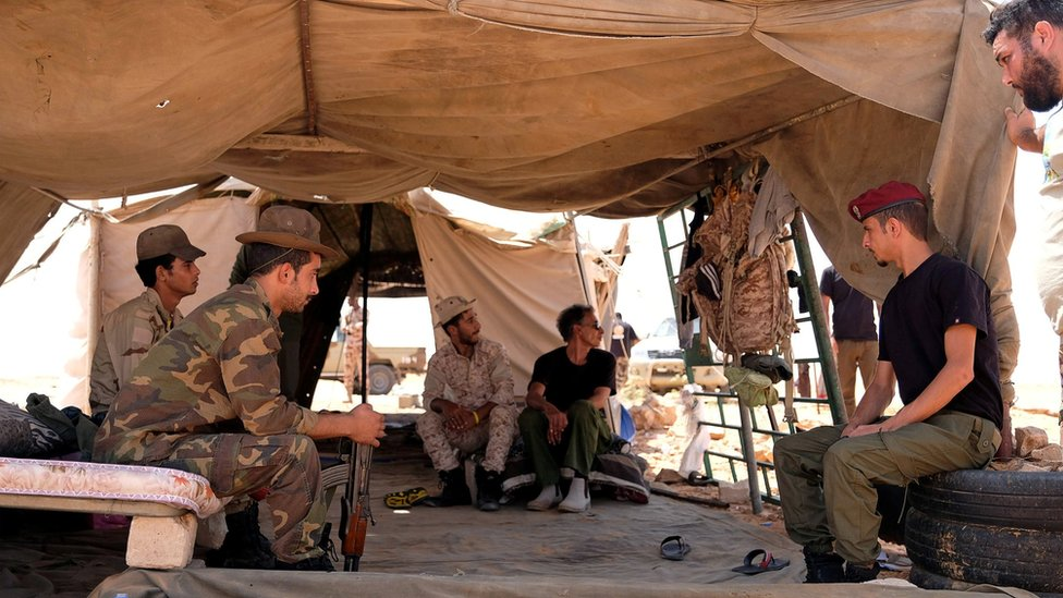Members of the Libyan National Army (LNA) commanded by Khalifa Haftar sit inside a tent at one of their sites in west of Sirte, Libya August 19, 2020