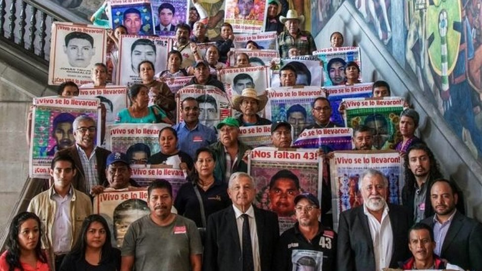 President Andres Manuel Lopez Obrador poses for a picture with relatives of some of the 43 students of the teaching training school in Ayotzinapa who went missing in 2014, at the Palacio Nacional, in Mexico City on September 11, 2019