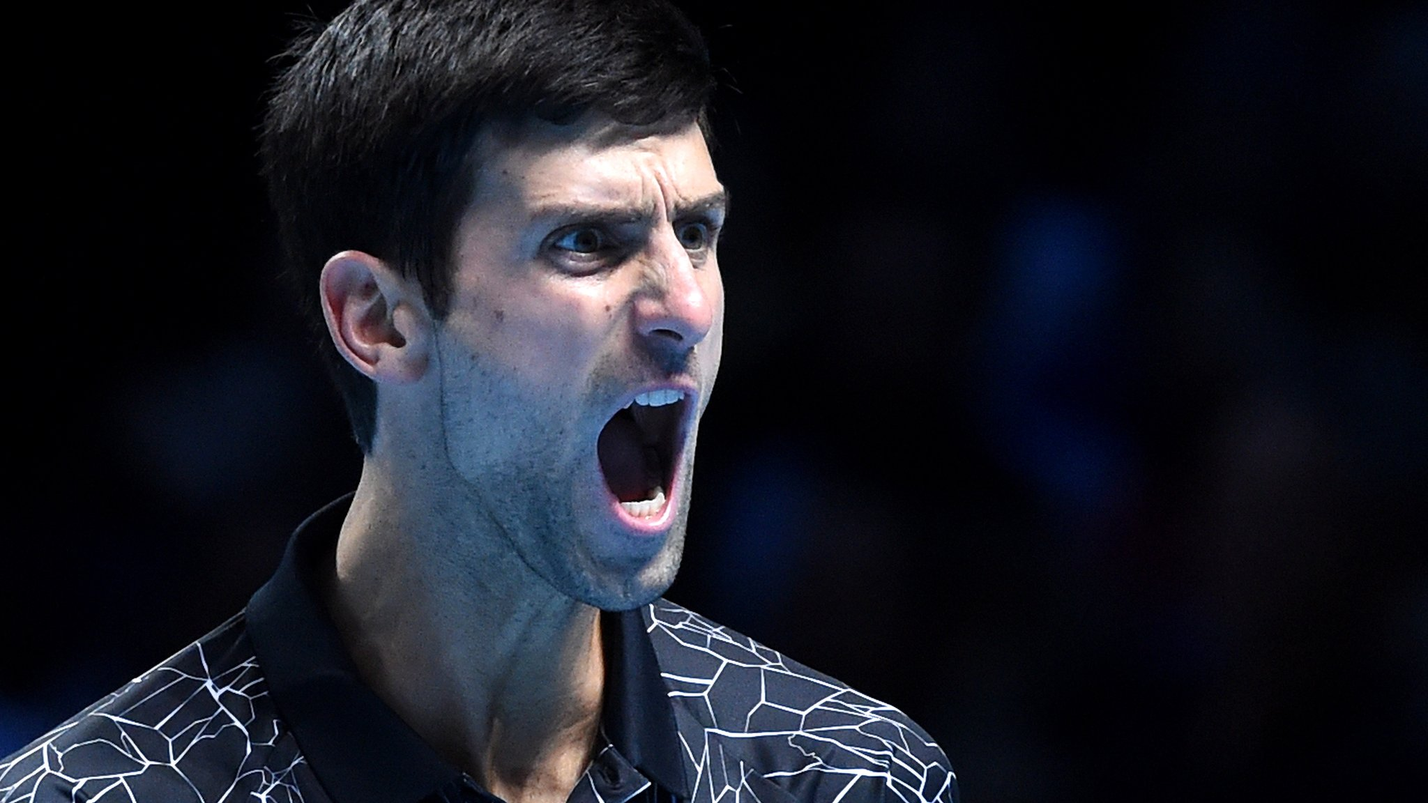 Dominant Djokovic beats Isner in ATP Finals opener