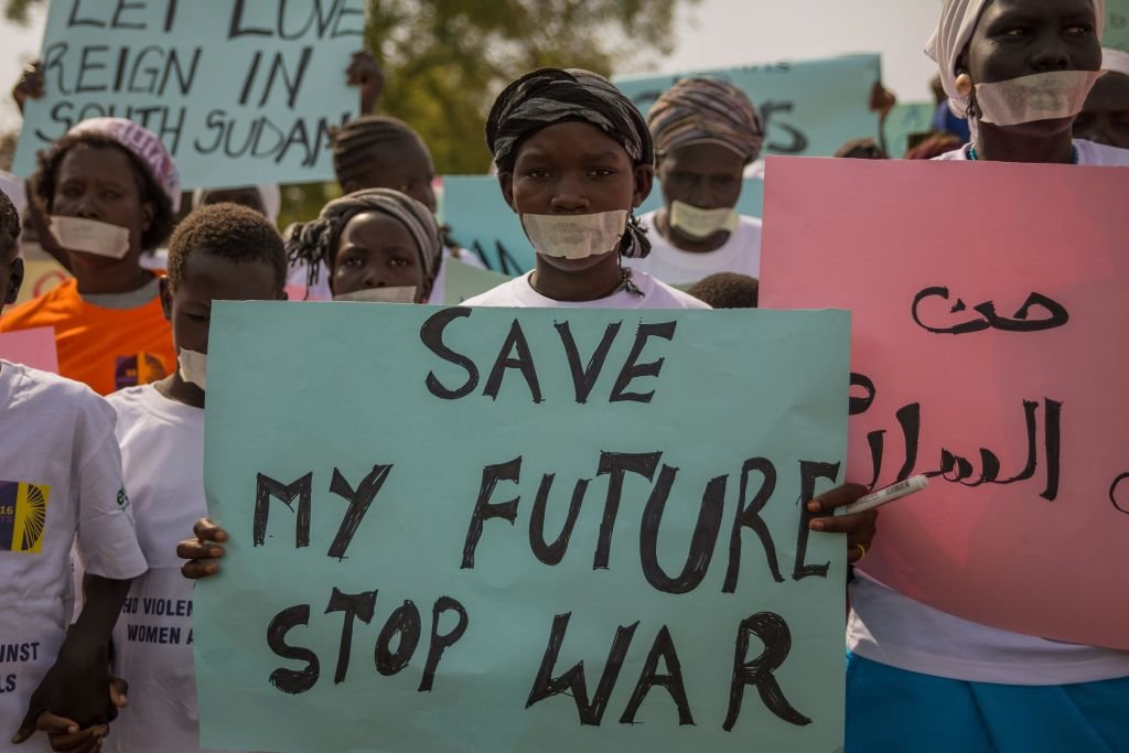 Women from more than forty South Sudanese womens organizations carry placards as march through the city to express the frustration and suffering that women and children face in Juba, South Sudan on December 9, 2017.