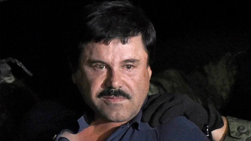 """Joaquin """"El Chapo"""" Guzman is escorted into a helicopter at Mexico City's airport on January 8, 2016 following his recapture during an intense military operation in Los Mochis, in Sinaloa State."""