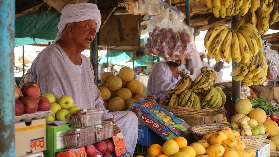 A Sudanese man sells fruit at a market in Shendi, the hometown of President Omar al-Bashir, located on the banks of the Nile in Sudan's Arab heartland 190 kilometres (120 miles) from Khartoum on April 1, 2015