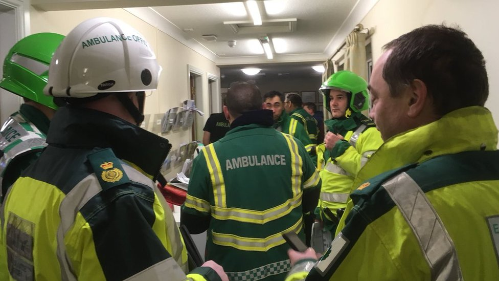East of England Ambulance staff at the care home in Stevenage.