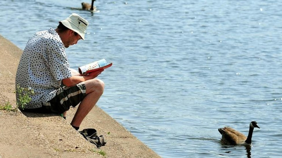 Man reading by River Trent