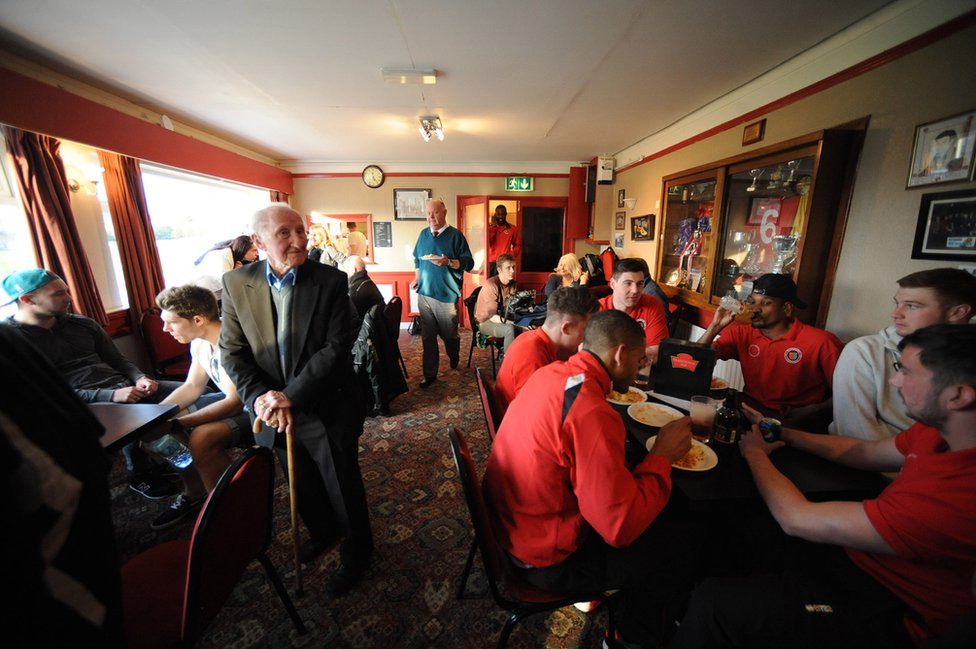 Stamford players gather in the bar