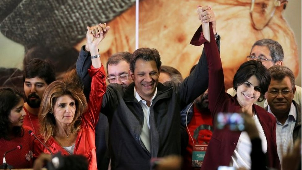 Fernando Haddad (R), presidential candidate of Brazil's leftist Workers' Party (PT), reacts with supporters, in Sao Paulo, Brazil October 7,
