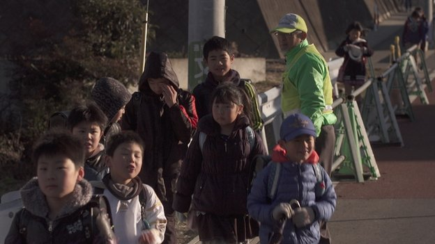 Lollipop man at school crossing