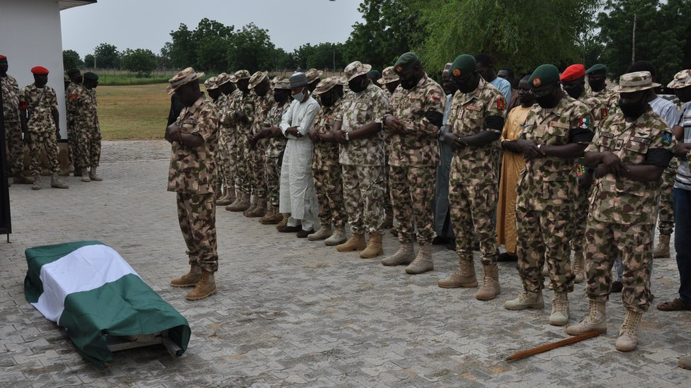 Nigerian soldiers are seen during the funeral on September 26, 2020 of their fellow servicemen killed in the attack