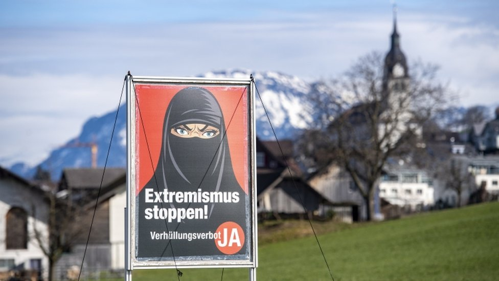 """A poster promoting """"Yes to the burka ban"""" is seen in Oberdorf, in the canton of Nidwalden, Switzerland, 16 February 2021"""
