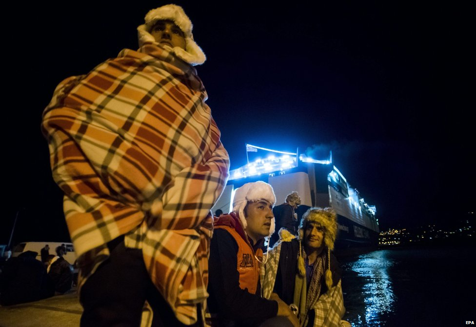 Migrants wait to board a ferry for Athens in the port of Mitilini, on the Greek island of Lesbos, 3 December 2015