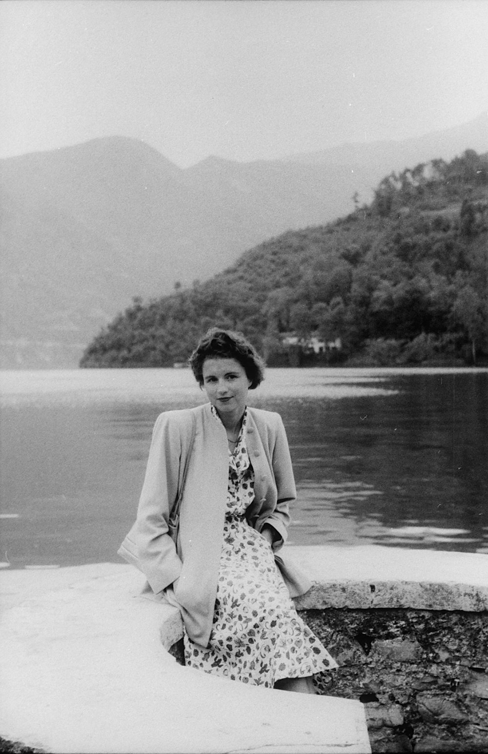 Woman beside a lake