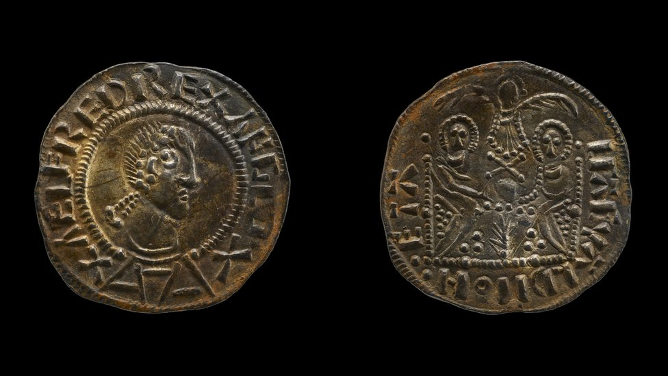 The faces of a Double Emperor coin