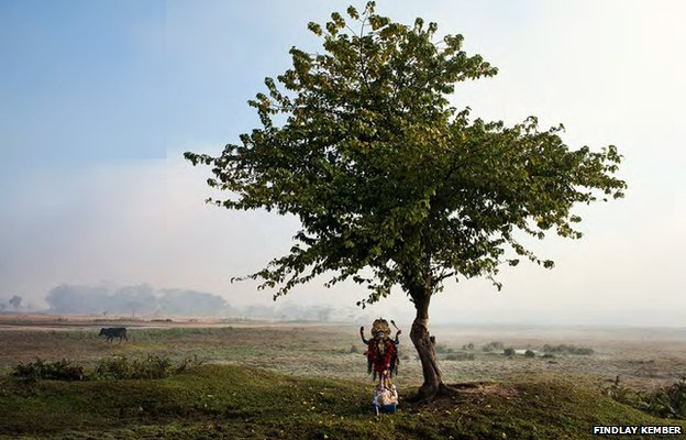 An idol of Kali stands under a tree on a World War Two airfield
