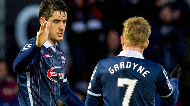 Ross County's Brian Graham celebrates after making it 4-2