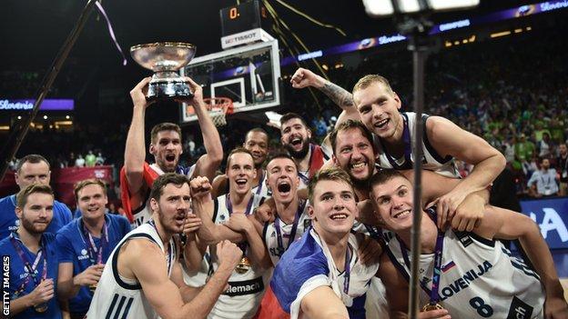 Slovenia's winning team celebrate their EuroBasket title