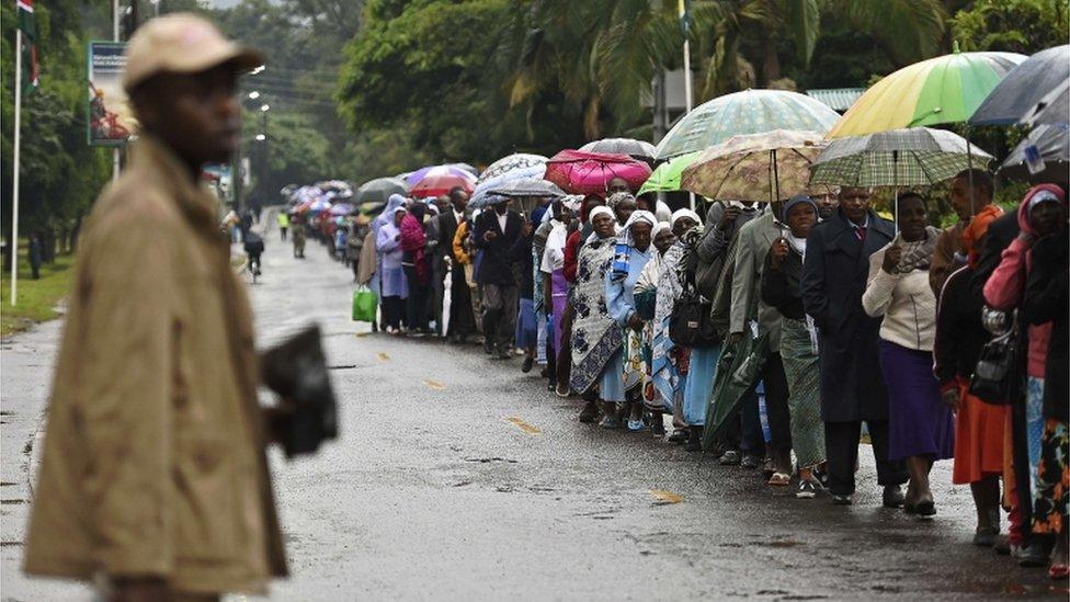 Crowd in the rain