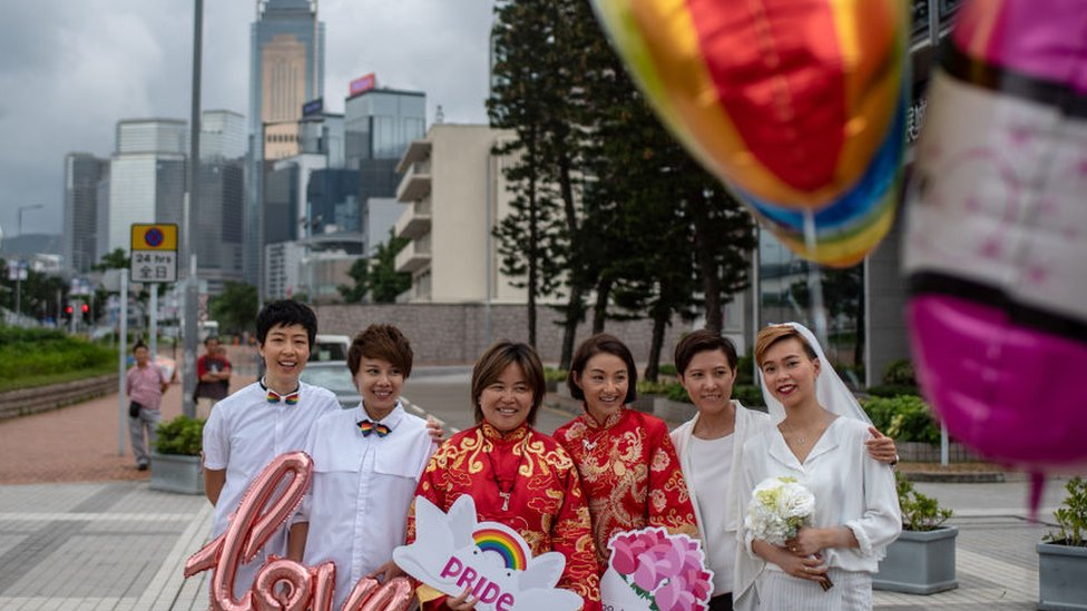 Same-sex couples attend an event to raise awareness of gay rights in Hong Kong on May 25, 2019, one day after Taiwan made history with Asia's first legal gay weddings.