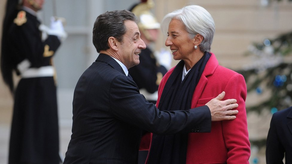 French President Nicolas Sarkozy (L) welcomes IMF chief Christine Lagarde at Elysee Palace on January 11, 2012 in Paris, France.