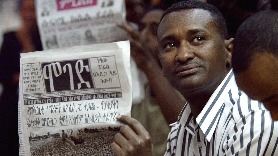Man reads a newspaper in Addis Ababa