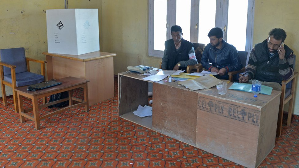 Polling officers inside an empty police station
