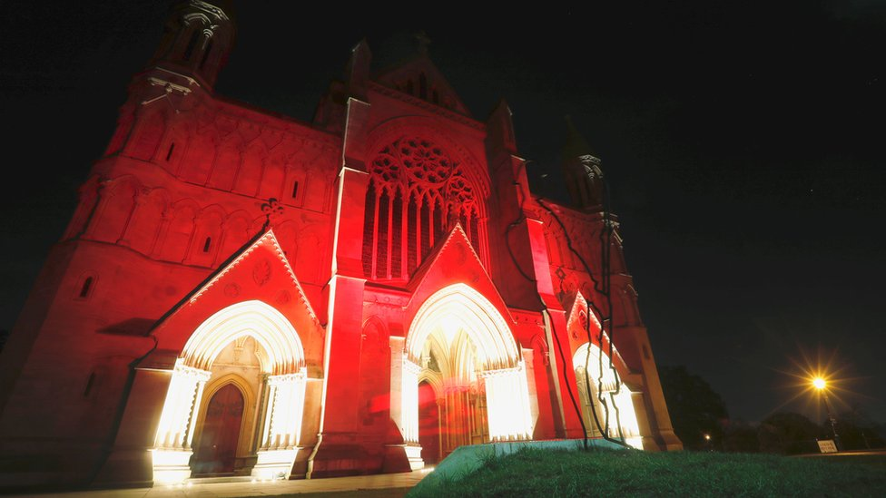St Albans Cathedral is bathed in red light